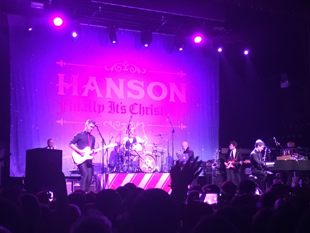 Hanson performing onstage