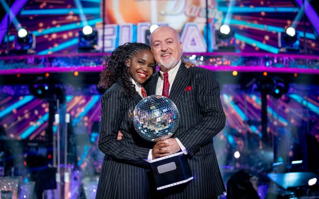 Bill Bailey and Oti Mabuse holding the glitterball trophy in the final of Strictly Come Dancing 2020