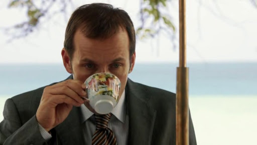 Richard Poole (Ben Miller) drinks from a small teacup.