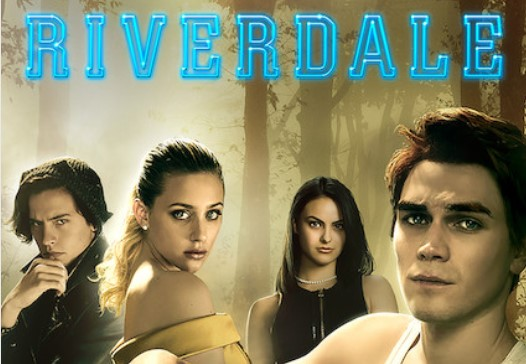 A promotional image for Riverdale featuring, left to right, Cole Sprouse, Lili Reinhart, Camila Mendes and KJ Apa, against a misty forest background.